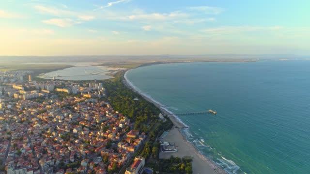 gorgeous aerial view of the sea garden in burgas, bulgaria drone flying backwards - bułgaria filmów i materiałów b-roll