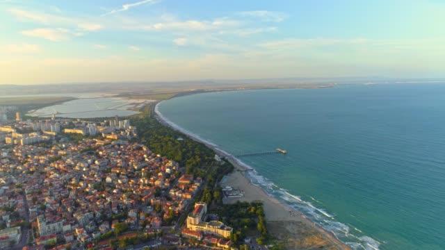 gorgeous aerial view of the sea garden in burgas, bulgaria drone flying forward - bułgaria filmów i materiałów b-roll