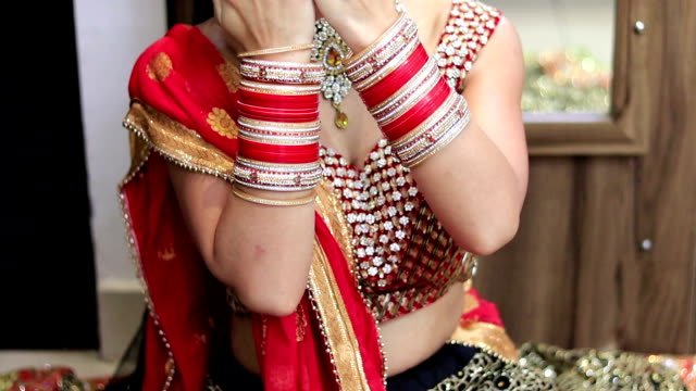 Gorgeous beautiful young Indian bride posing for photographer