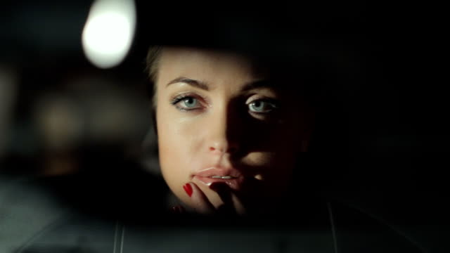 Gorgeous blonde corrects make-up inside the car video