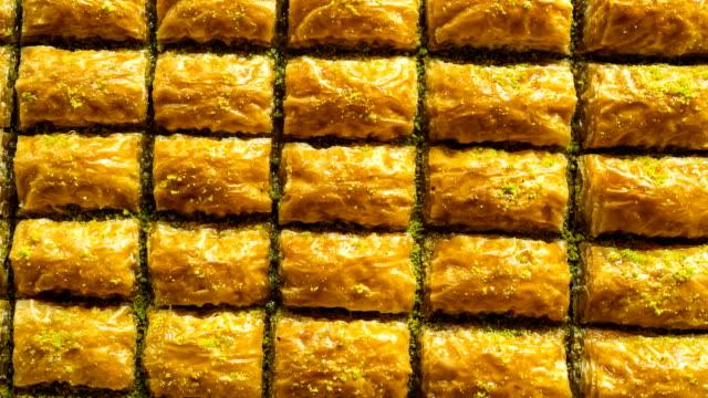gorgeous delicious traditional pistachio turkish baklava, baklava pattern - поститься стоковые видео и кадры b-roll