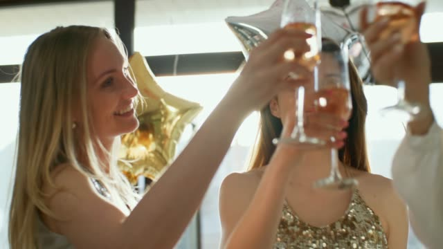 Gorgeous girls celebrate with champagne
