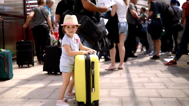 gorgeous toddler waiting in line to board a plane - 2 3 anni video stock e b–roll