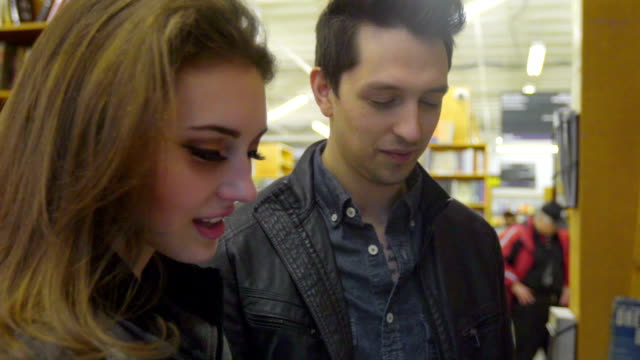 Gorgeous Woman and Man look at book together video
