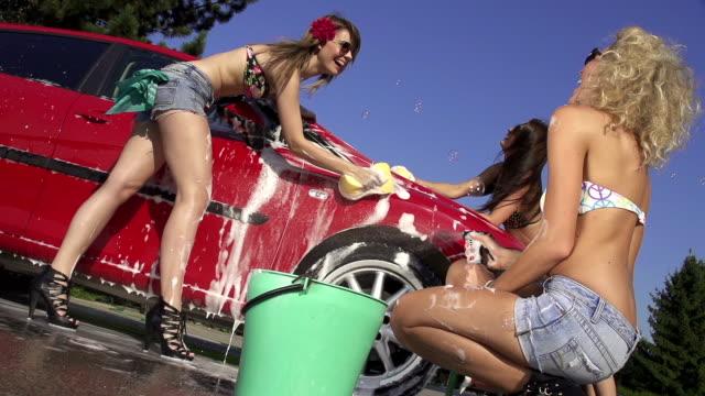 SLOW MOTION: Gorgeous young women washing a car