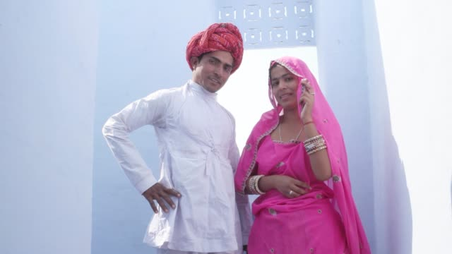 ecc6a4f410 Gorgeously Cool Indian Couple With Traditional Clothing Pose With Attitude  Looking Down On The Camera In Rajasthan India Stock Video & More Clips of  4K ...