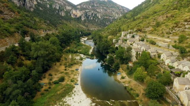 Gorges du Tarn River Valley and Village Aerial River and a village at the valley of the Gorges du Tarn filmed from the air. Pull back shot. provence alpes cote d'azur stock videos & royalty-free footage