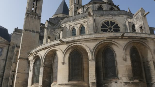 Gothic architecture details of Mens Abbey  in Normandy France by the day 4K Gothic architecture details of Mens Abbey  in Normandy France by the day 4K 3840X2160 slow tilt UltraHD footage - Detailed  French  Abbaye aux Hommes in city of Caen Normandie 4K 2160p UHD video caen stock videos & royalty-free footage