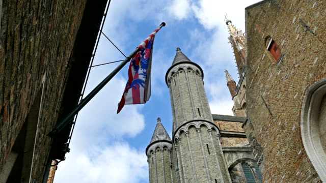 Gothic facade and tall belfry of the Church of Our Lady, Bruges, Belgium video
