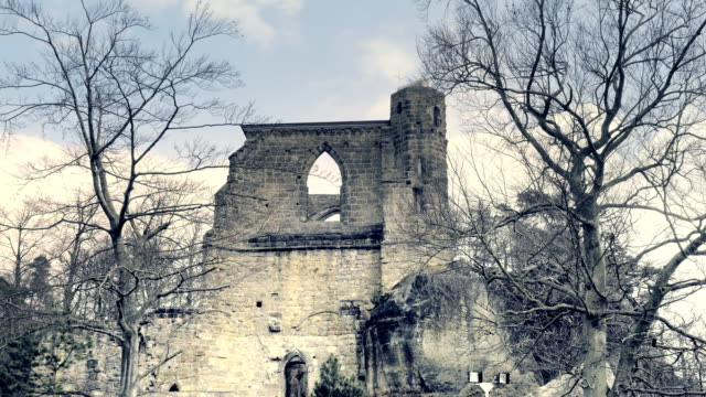 Gothic stone window with arched arch. Gothic cathedral without roof. Gothic stone window with arched arch. Gothic cathedral, ruins of medieval castle. Royal City. Spring sunny day, without people. Oybin in Germany. neo gothic architecture stock videos & royalty-free footage