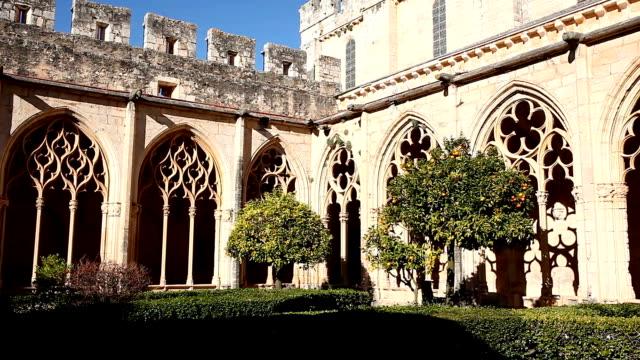 Gothic vaulted arcade in cloister of Monastery of Santa Maria de Santes Creus