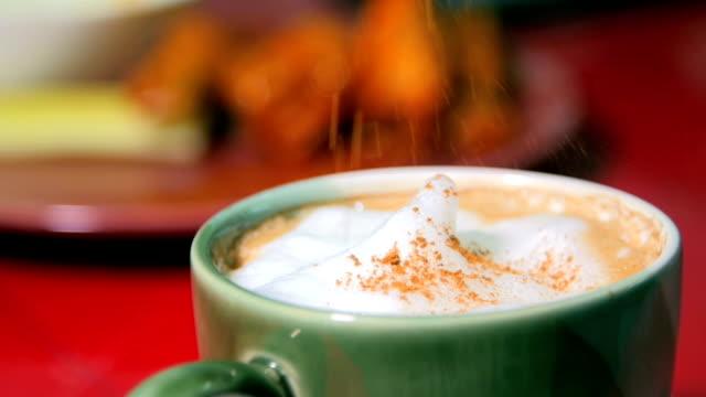 gourmet coffee slowly filled in a green coffee cup. slow motion - espresso filmów i materiałów b-roll