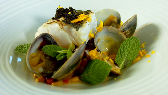 Gourmet cooking bass fish with clams video