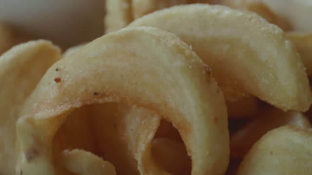 Gourmet Curly Potato French Fries Close Up Macro View Fried Fast Food video