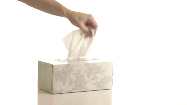 Grabbing Tissues Hand grabs tissues from box multiple times. Isolated on white gripping stock videos & royalty-free footage