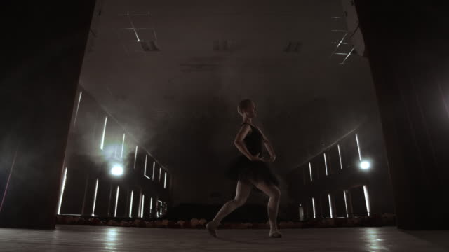 Graceful Ballerina In White Dress Dancing Elements Of Classical Or Modern Ballet In The Dark With.