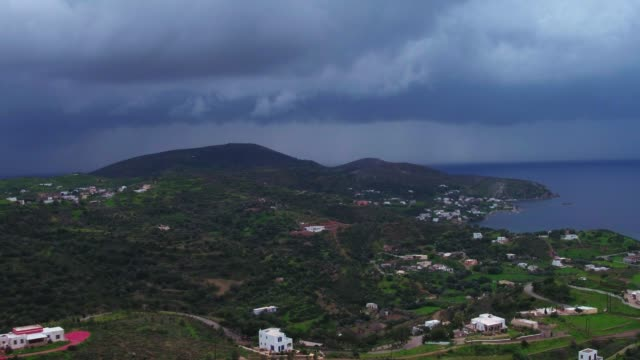 Graded footage - Aerial - Drone - Leros Island - Aegean Sea - Dodecanese - straight flight over a traditional town in Leros Island, in stormy weather at  winter video