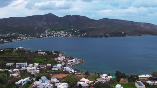 Graded footage - Aerial - Drone - Leros Island - Aegean Sea - Dodecanese - straight flight over a traditional town in Leros Island and a harbor video
