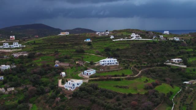 Graded footage - Aerial - Drone - Leros Island - Aegean Sea - Dodecanese - straight flight over a homes and hills in Leros Island, in stormy weather at  winter video