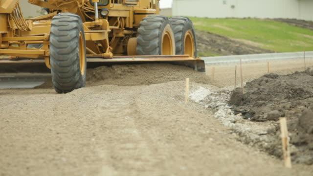 Grader Smoothing Gravel Surface for Asphalt Road video