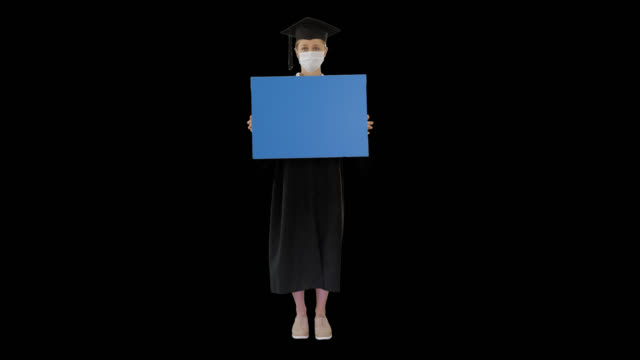 Graduate student girl in protection mask holding blank board, Alpha Channel