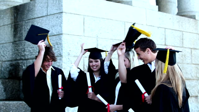 Graduates throwing mortar boards in the air video