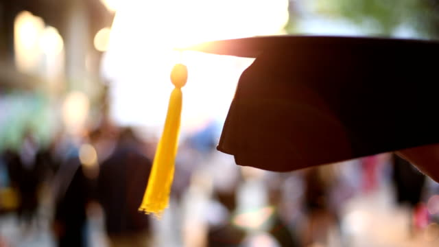 Graduation cap in the hands of graduates Graduation cap in the hands of graduates congratulating stock videos & royalty-free footage