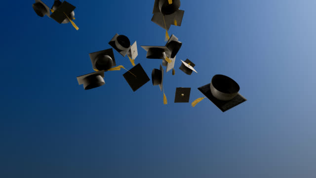 Graduation Caps Slow Motion 1080p HD Stock Video of Graduation caps being tossed in to the sky in slow motion. student stock videos & royalty-free footage