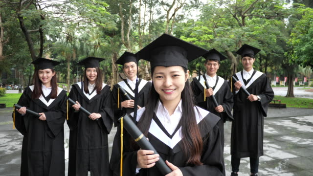 Graduation in East Asia - young woman graduated on Law and Economics Faculty.