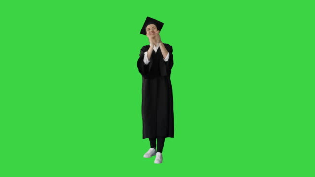Graduation student woman applauding smiling on a Green Screen, Chroma Key