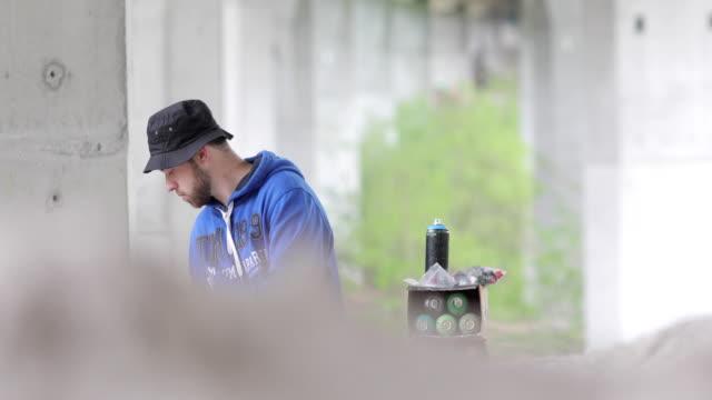 Graffiti Artist Beginning to Draw Graffiti on Wall