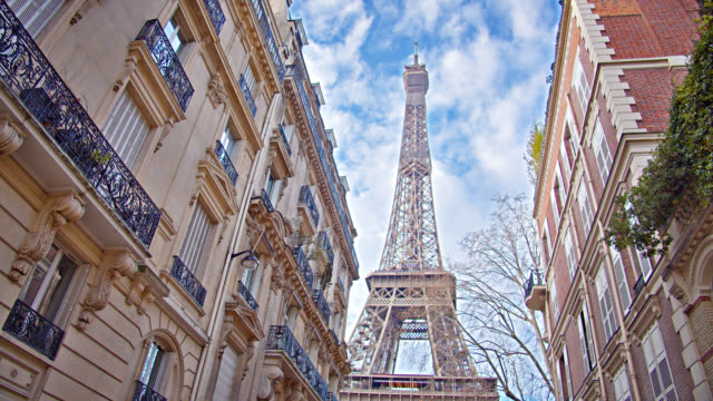 Grand Classical View of Eiffel Tower Between Residential Old-Fashioned Buildings in Paris