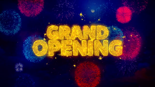 Grand Opening Greeting Text Sparkle Particles on Colored Fireworks video