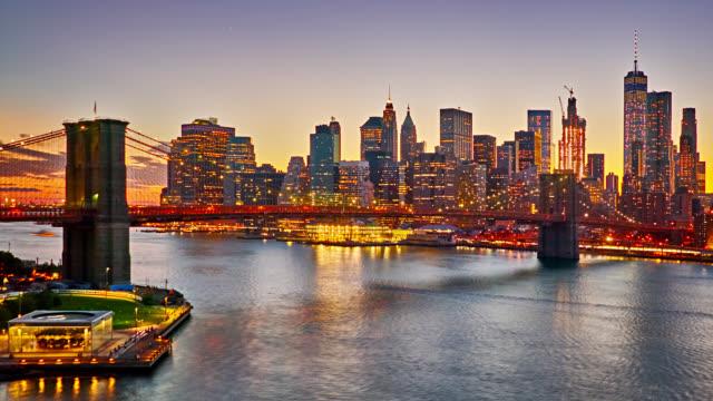 Grand Sunset. New York. Brooklyn Bridge. Manhattan Financail District.