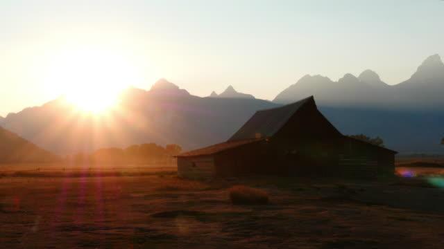 Grand Teton National Park, WY, USA Timelapse. Sunset at Mormon Row Historic District, Grand Teton National Park, WY, USA barns stock videos & royalty-free footage