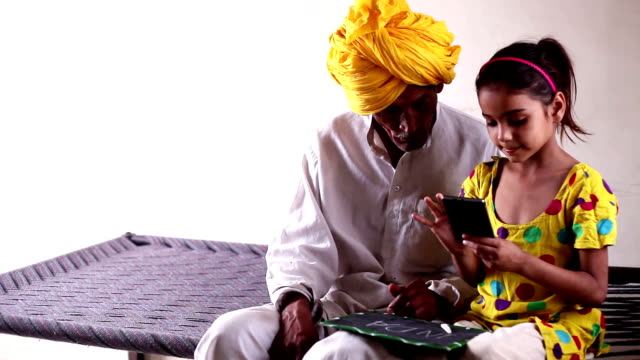 grandchild studying with her grandparents. - haryana video stock e b–roll