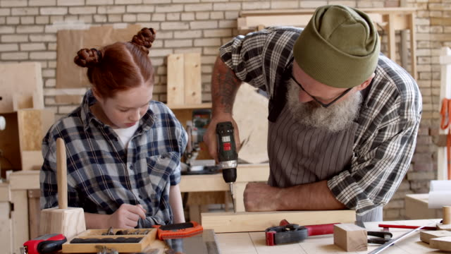 Granddad and Granddaughter in Joinery