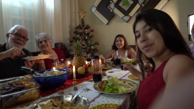 Granddaughter taking a selfie at Christmas Dinner