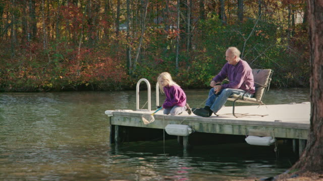 Grandfather and Granddaughter Fishing in Nature - MS video