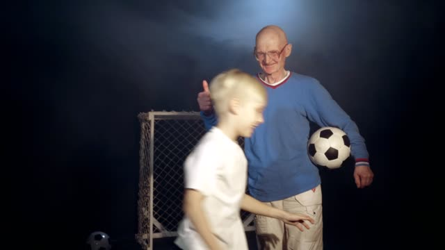 Grandfather And Grandson Footballers video