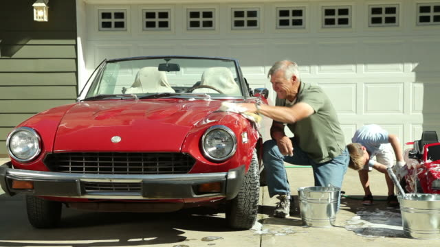 Grandfather and Grandson wash cars together video