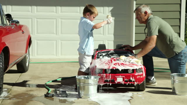 Grandfather and Grandson wash toy car together video