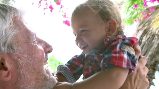 grandfather at home playing with grandson in garden - grandparents stock videos & royalty-free footage