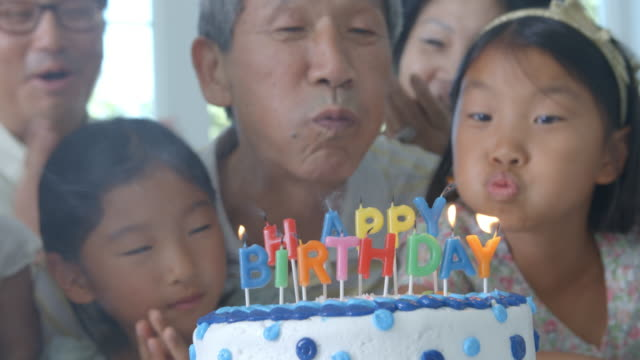 Grandfather Blows Out Candles On Birthday Cake video
