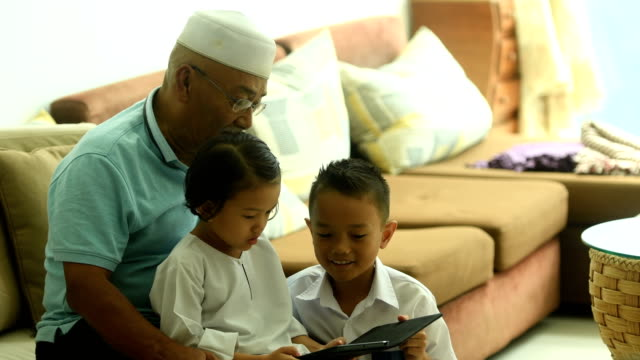 grandfather bonding with his grandchildren with technology - malaysia video stock e b–roll