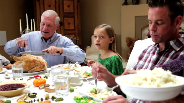 Grandfather Carving Turkey At Family Thanksgiving Meal video