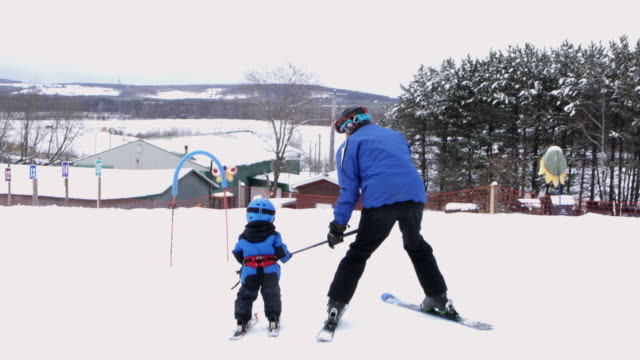 Grandfather Teaching Baby Son Ski Resort Weekend Amateur Winter Sport