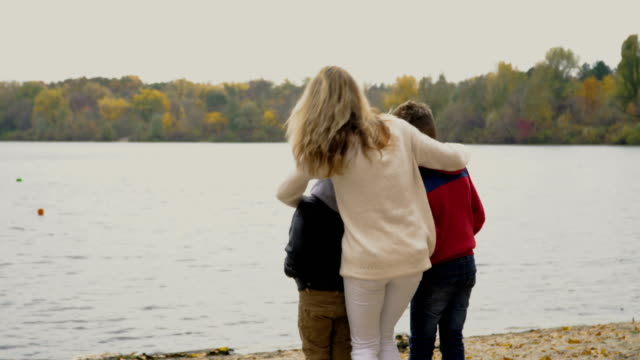 Grandfather with adult daughter with little sons enjoys view of the river video