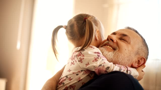 Grandfather With His Granddaughter Grandfather And His Granddaughter Hugging In The Living Room granddaughter stock videos & royalty-free footage