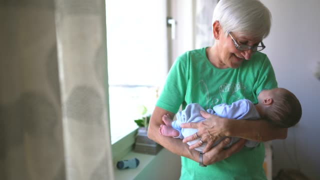 grandma first time seeing new family member - grandparents stock videos & royalty-free footage